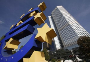 A huge Euro logo is pictured past the headquarters of the European Central Bank (ECB) in Frankfurt
