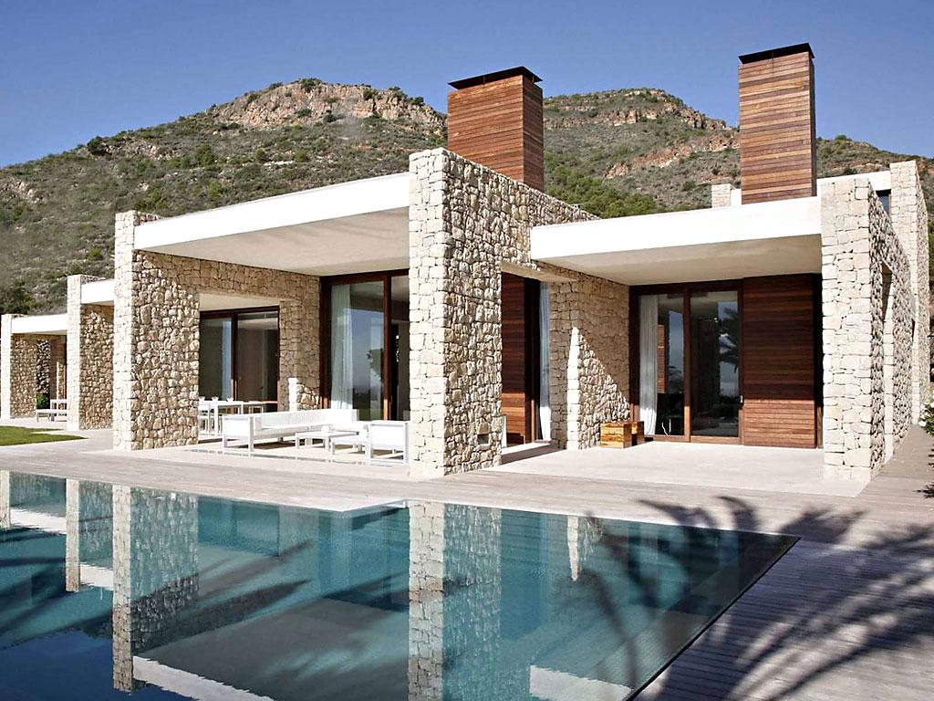 casaypiscina11 - Muros de piedra y patios en busca de luz en una espectacular casa en Valencia