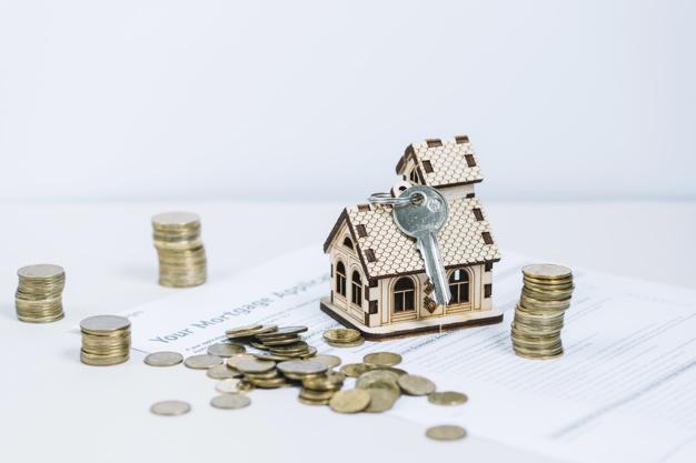 dinero cerca llave casa 23 2147797558 - ¿Que ocurre si no se inscribe una vivienda en el Registro de la Propiedad?