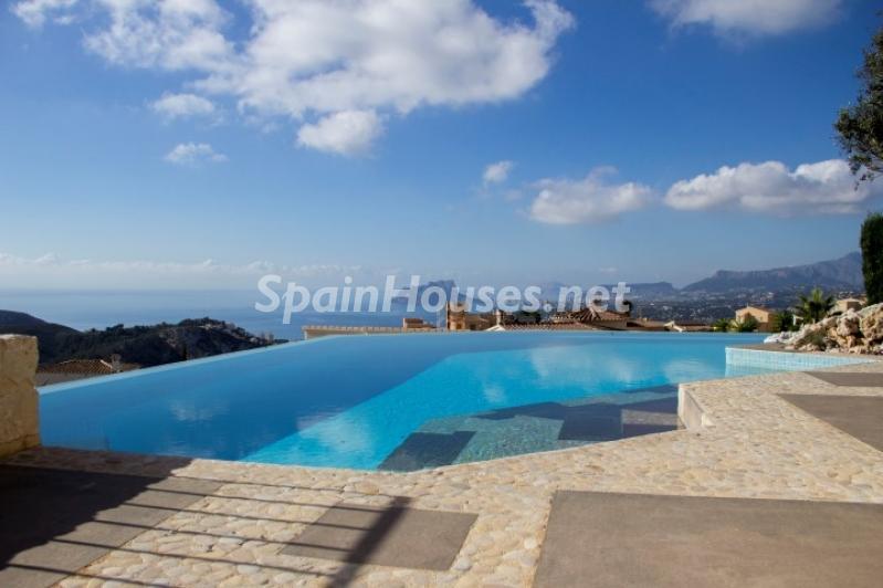piscina 10 - Lujosa casa vestida de piedra en Benitachell (Costa Blanca) con vistas panorámicas al mar
