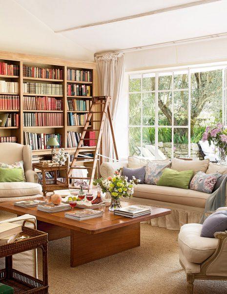 salon biblioteca con libreria a medida y escalera 992x1280 465x600 - La Ferme du Bon Dieu: Una granja convertida en casa que alberga una historia de amor